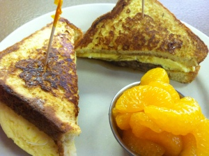 French Toast Sandwich with Egg, Veggie Sausage, Maple Syrup